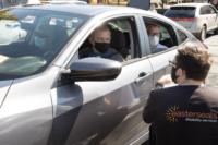 Patrick from Easterseals screens car full of seniors from Brea Senor Center