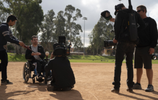 Crew shooting batter on field in his wheelchair
