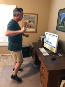John exercising in front of the computer