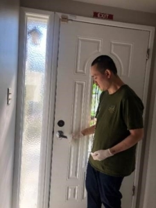 Jonathan cleaning door handle