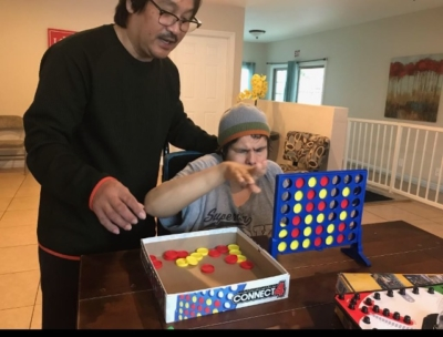 Peter Caranto playing Connect Four with Martin