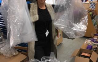 Maria Avila holding up bags