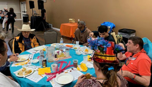 Seniors sitting at festively decorated table