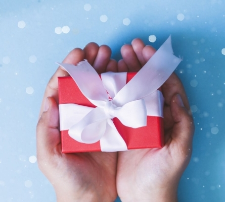 Hands holding out a gift